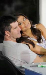 paula-abdul-sitting-on-simon-cowell-lap-romance